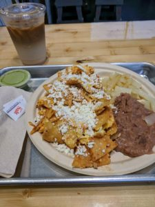 Chilaquiles on a metal tray