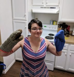 The author wearing two potholders.
