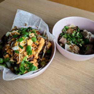 bowl of bulgogi tots and bowl of dumplings